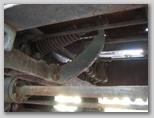 Кронштейн крепления возвратной пружины тяги тормоза трактора