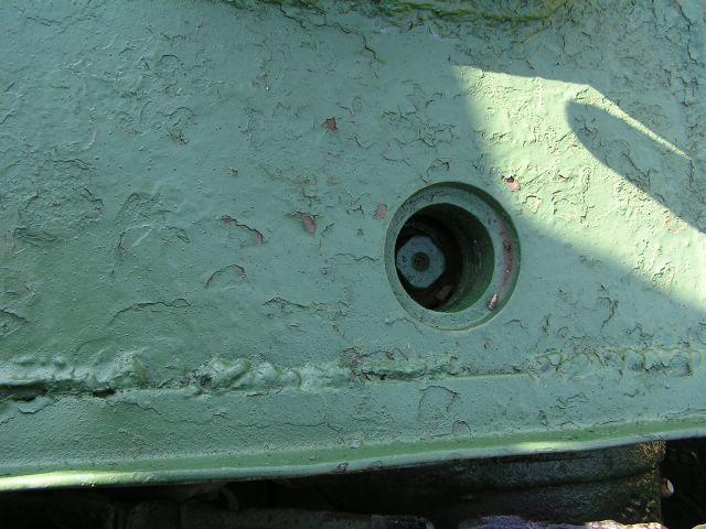 Привод механизма натяжения гусениц