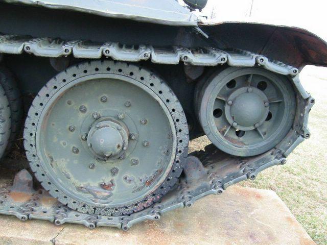 Опорный каток и направляющее колесо