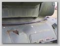 Выштамповка в лобовом листе, над головой механика-водителя