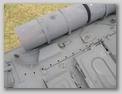 Отражатель выхлопа и выпускной колпак на корпусе танка